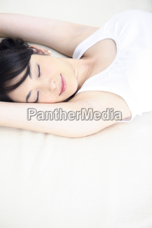 woman taking nap in bed