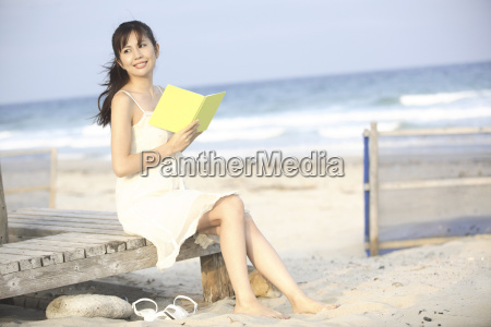 japanese woman reading a book on