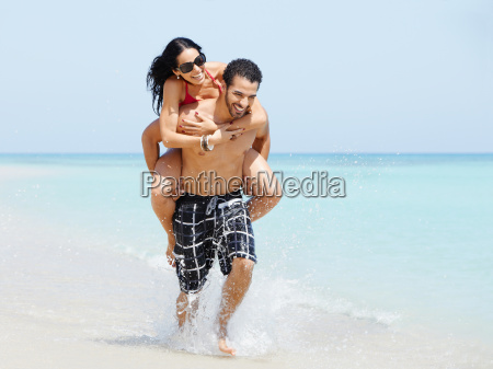 piggyback ride with happy man and
