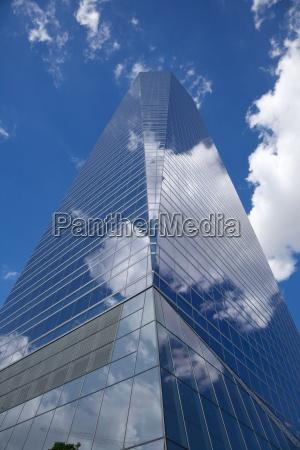 clouds on skyscraper