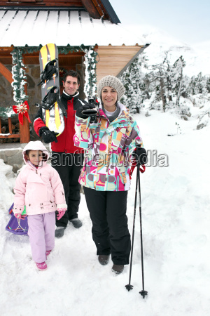 family enjoying skiing holiday