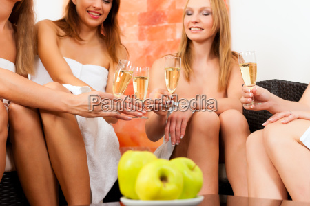 wellness friends drinking champagne in