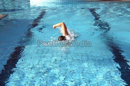 a man swims crawl
