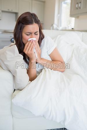 brunette woman feeling sick and lying
