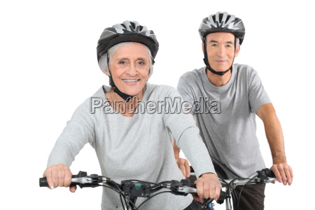 elderly couple cycling