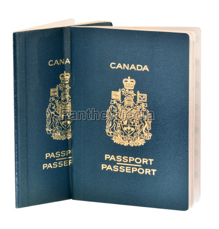 two canadian passports isolated on white