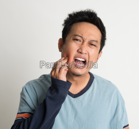 asian male toothache