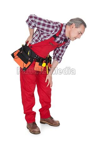 male technician suffering from knee pain