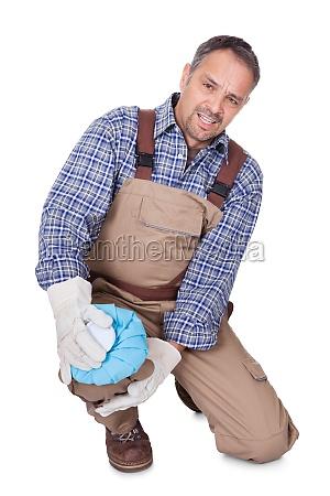 construction man having knee pain