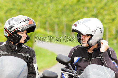 two motorcyclists with radio connection