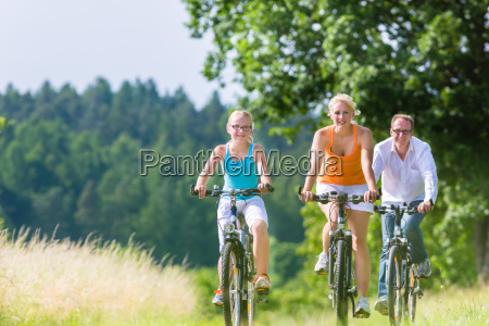 family driving together a weekend bike