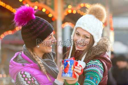 friends drinking mulled wine at the