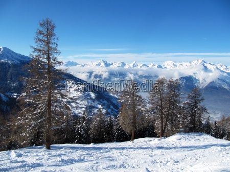 winter alpine mountain scene under a
