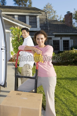 couple moving house man beside van