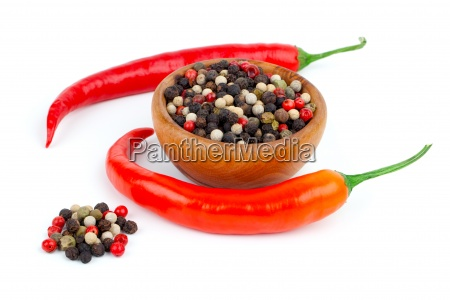 red chili and pepperon white background