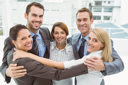business people with arms around in