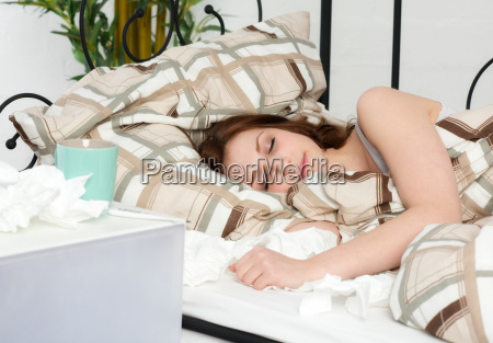 young woman lying in bed sleeping