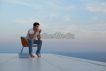relaxed young man at home on