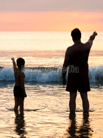 silhouette of father and son in