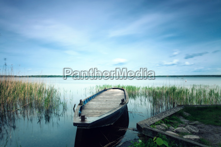 wooden boat on the shore