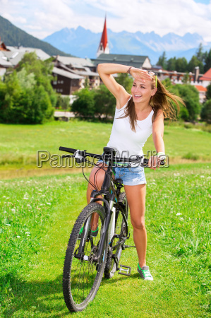 happy girl biking in the mountains