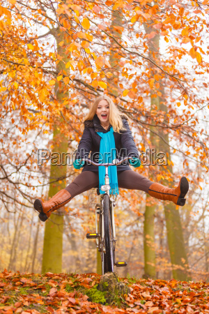 active woman having fun riding bike