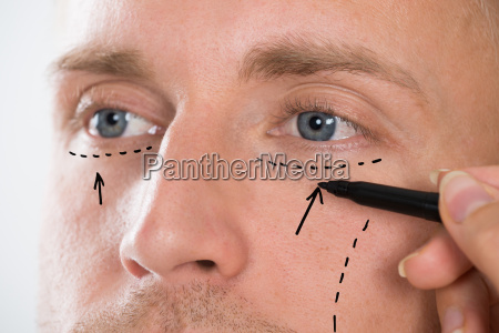 persons hand drawing correction line with