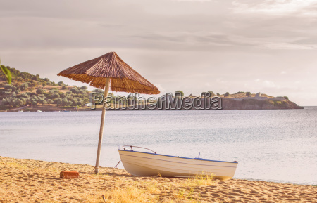 fishing boat on the sandy beach
