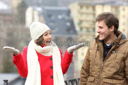 couple enjoying snow in a snowy