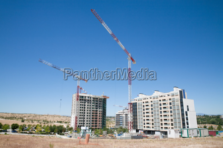 two cranes in construction side
