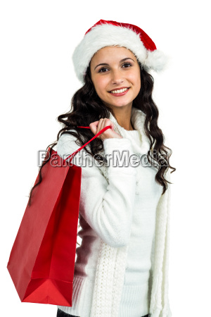 attractive woman with christmas hat holding