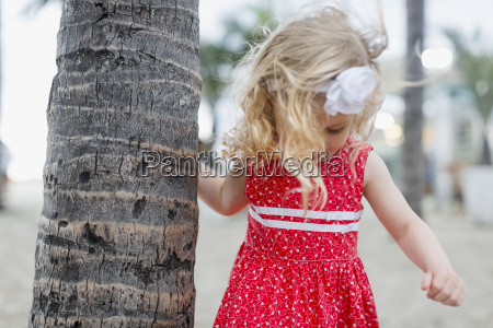 girl with hair band at palm