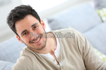 portrait of young man relaxing at