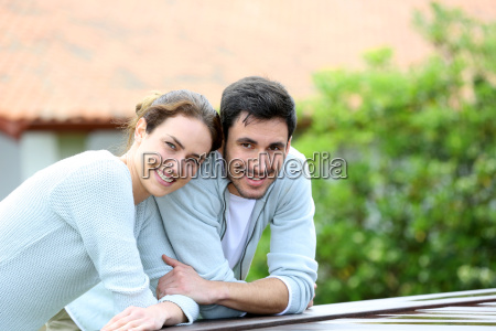 couple embracing each other in front