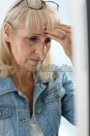 senior woman in office having a