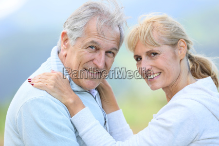 senior people embracing each other with
