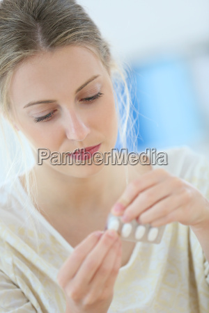 beautiful blond woman having a headache