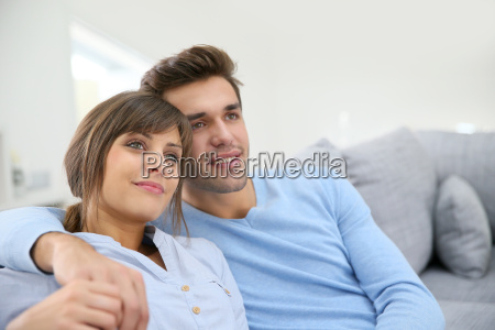 young couple relaxing in sofa looking