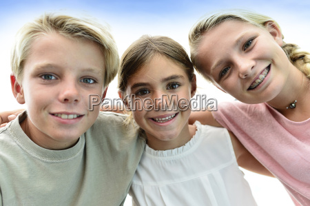 portrait of kids with arms around