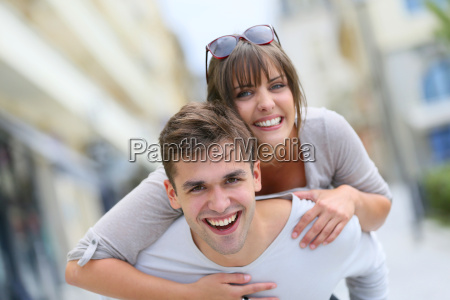 young man giving piggyback ride to