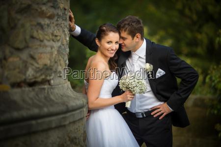 beautiful happy younf wedding couple in