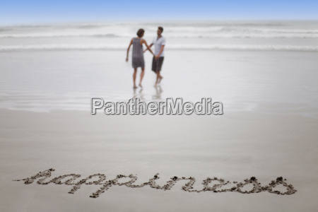 happiness in sand with couple on