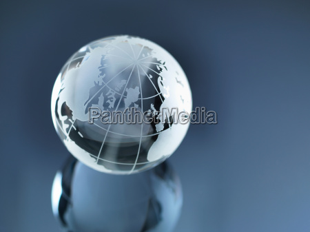 glass globe illustrating north and south