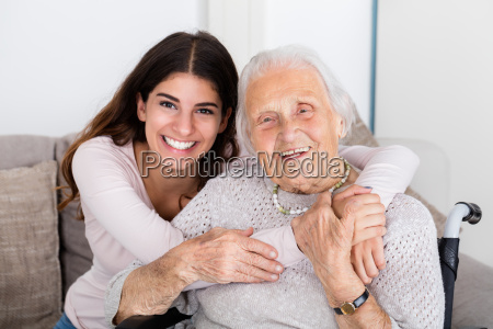 two women embracing each other at