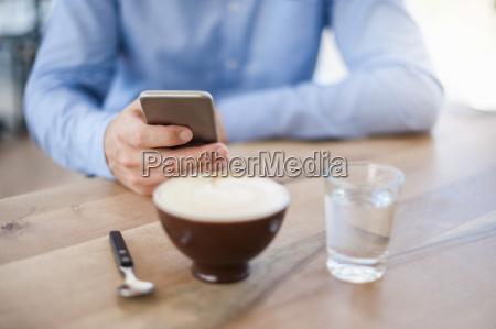 hand of man holding smartphone close