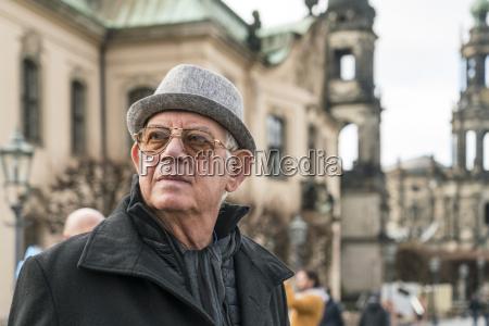 germany dresden happy senior man standing