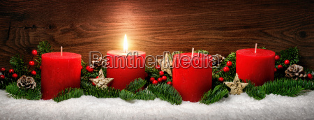 advent decoration with a candle flamesnowfir