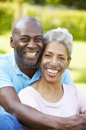 outdoor portrait of romantic mature couple