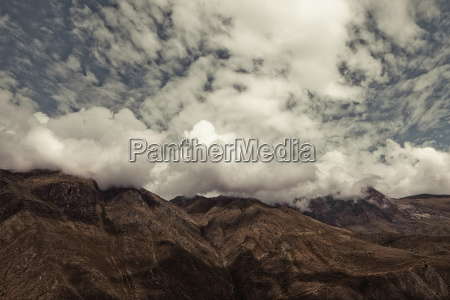 view of clouds on mountains ollantaytambo