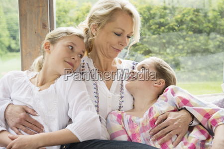 mother with arms around daughters